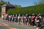 "Nether  Stowey Female Friendly Society ( The Womens Walk ) Club Day. Local women and flower girls walk from the village to the grave of Tom Poole ) founder 1806) at St Marys Church. Dress code ""formal, with hat and posy of flowers."" Nether Stowey Somerset 2014."