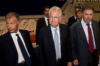 il presidente del Consiglio  Mario Monti in visita al Meeting di Comunione e liberazione 2012, alla sua dx Giorgio Vittadini di CL presidente della Fondazione per la Sussidiarietà