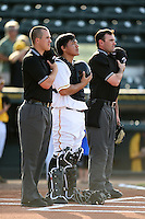 Bradenton Marauders catcher Jin-De Jhang (47) in the center of umpires Brennan Miller (left) and Scott Costello (right) during the national anthem before a game against the Jupiter Hammerheads on June 25, 2014 at McKechnie Field in Bradenton, Florida.  Bradenton defeated Jupiter 11-0.  (Mike Janes/Four Seam Images)