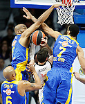 Real Madrid's Rudy Fernandez (c) and Maccabi Electra Tel Aviv's Alex Tyus (l), Devin Smith (d) and Brian Randle (r) during Euroleague match.March 27,2015. (ALTERPHOTOS/Acero)