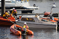 "Aberystwyth Wales UK  Wednesday 31 August 2016<br /> Pictured: RNLI crew with the small motor boat that they recovered.<br /> Re: Re: A man tried to save his friend who died after falling out of a speedboat, an inquest has been told.<br /> William George Davies, 63, from Borth, died in August after he was thrown overboard during a fishing trip off Aberystwyth.<br /> A second man, Alan Jones, was also thrown overboard but survived.<br /> The inquest at Aberystwyth Justice Centre was told the cause of death was drowning and coroner Peter Brunton recorded a conclusion of misadventure.<br /> Mr Brunton said he had ""concerns"" over the fact the two men were not wearing life jackets, the sea had been ""choppy"" and Mr Jones had taken off the kill cord which would automatically stop the engine if he were thrown overboard.<br /> The inquest heard the men had set out at about 7.30am on 31 August to go fishing, but headed to Aberystwyth harbour a short time later when Mr Davies started to feel unwell - which his friend put down to sea sickness."