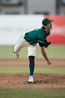 Greensboro Grasshoppers relief pitcher Grant Ford (41) follows through on his delivery against the Hickory Crawdads at First National Bank Field on May 6, 2021 in Greensboro, North Carolina. (Brian Westerholt/Four Seam Images)
