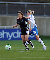 Washington Freedom midfielder Homare Sawa (10) maintains control while being pulled from behind by Boston Breaker midfielder Kelly Smith (10) Boston Breakers defeated Washington Freedom 3-1 at The Maryland SoccerPlex, Saturday April 18, 2009.