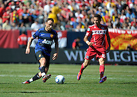 Manchester United forward Dimitar Berbatov (9) plays the ball as Chicago Fire midfielder Marco Pappa (16) looks on.  Manchester United defeated the Chicago Fire 3-1 at Soldier Field in Chicago, IL on July 23, 2011.