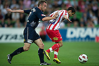 MELBOURNE, AUSTRALIA - DECEMBER 11: Grant Brebner of the Victory and Aziz Behich of the Heart compete for the ball during the round 18 A-League match between the Melbourne Heart and Melbourne Victory at AAMI Park on December 11, 2010 in Melbourne, Australia. (Photo by Sydney Low / Asterisk Images)