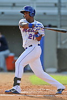Kingsport Mets third baseman Pedro Perez #21 swings at a pitch during a game against the Elizabethton Twins at Hunter Wright Stadium on June 29, 2013 in Kingsport, Tennessee. The Mets won the game 5-4. (Tony Farlow/Four Seam Images)