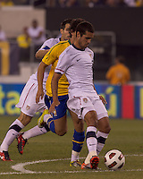 USA defender Jonathan Spector (2) passes the ball. Brazil  defeated the US men's national team, 2-0, in a friendly at Meadowlands Stadium on August 10, 2010.