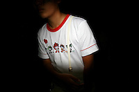 CHINA. Beijing. A spectator wearing a t-shirt depicting the Olympic mascots during the Beijing 2008 Summer Olympics. 2008