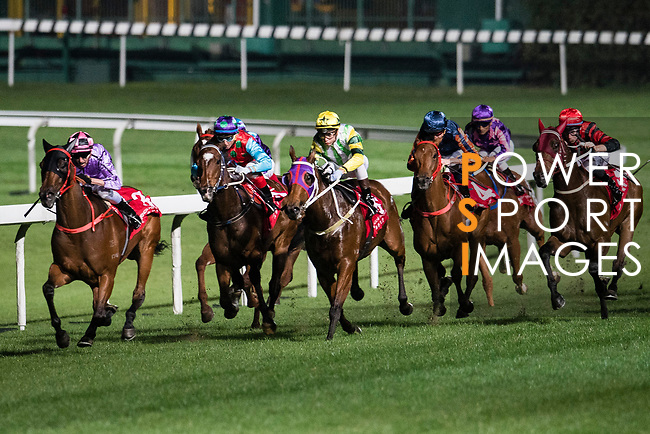 Jockey Nash Rawiller riding Who Else But You (L) during Hong Kong Racing at Happy Valley Race Course on December 06, 2017 in Hong Kong, Hong Kong. Photo by Marcio Rodrigo Machado / Power Sport Images