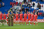 Wales' players observe a minute's silence to remember those that died in Wars defending the Country ahead of the.Wales v Norway Vauxhall international friendly match at the Cardiff City Stadium in South Wales..Editorial use only.