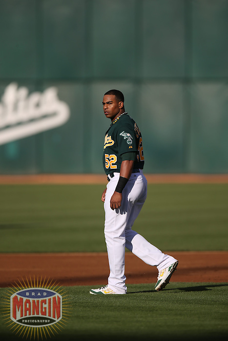OAKLAND, CA - MAY 18:  Yoenis Cespedes #52 of the Oakland Athletics walks on the field between innings during the game against the Kansas City Royals at O.co Coliseum on Saturday May 18, 2013 in Oakland, California. Photo by Brad Mangin