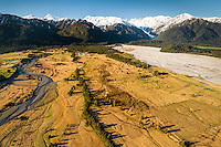 Aerial views of The Southern Alps and Franz Josef Glacier, Waiho River and Tatare Creek, Westland National Park, West Coast, World Heritage Area, New Zealand