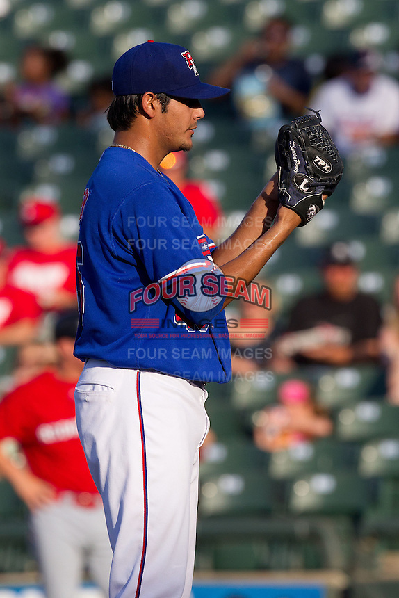 Round Rock Express pitcher Martin Perez #45 looks in for the sign during the Pacific Coast League baseball game against the Oklahoma City RedHawks on June 15, 2012 at the Dell Diamond in Round Rock, Texas. Perez pitched seven one hit innings as the Express shutout the RedHawks 2-1. (Andrew Woolley/Four Seam Images).