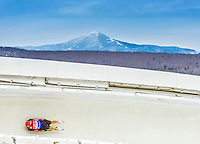 5 December 2014: Julian von Schleinitz, sliding for Germany, slides through Curve Number 14 on his first run, ending the day with a 23rd place finish and a combined 2-run time of 1:44.714 in the Men's Competition at the Viessmann Luge World Cup, at the Olympic Sports Track in Lake Placid, New York, USA. Mandatory Credit: Ed Wolfstein Photo *** RAW (NEF) Image File Available ***