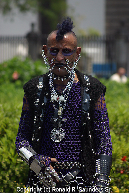 MAN WITH PIERCINGS AND METAL