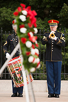 A bugler from the U.S. Army Band plays Taps during a wreath laying ceremony the Tomb of the Unknown Soldier at Arlington National Cemetery, March 11, 2016, in Arlington, Va. Prime Minister of Canada Justin Trudeau laid a wreath at the Tomb and the Canadian Cross of Sacrifice while at the cemetery. (U.S. Army photo by Rachel Larue/Arlington National Cemetery/released).