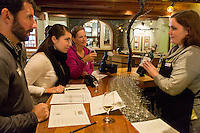 South Africa, Paarl area, near Cape Town.  Tourists enjoying a wine-tasting session at Fairview winery.