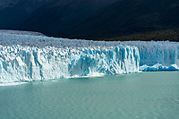 A section of the Perito Moreno Glacier calves dropping tons of glacial ice into Lago Argentino in Los Glaciares National Park near El Calafate, Argentina.  A UNESCO World Heritage Site in the Patagonia region of South America.