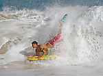 A boarder takes a on a wave at Sandy Beach in Hawaii during high-tide.