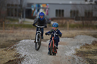 """Theo Howard, 7, (from left) and Levi Howard, 5, ride, Monday, January 11, 2021 along the Mama Bear trail in Bentonville. """"This one is honestly really fun for the kids, and one of the only ones you can ride when it's really muddy and cold out there,"""" said the boys' mom, Emily Howard of Bentonville. Check out nwaonline.com/210112Daily/ for today's photo gallery. <br /> (NWA Democrat-Gazette/Charlie Kaijo)"""