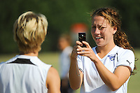 Lauren Cheney shoots video of Lori Lindsey prior to the start of the Women's Professional Soccer (WPS) All-Star practice at KSU Stadium in Kennesaw, GA, on June 29, 2010.