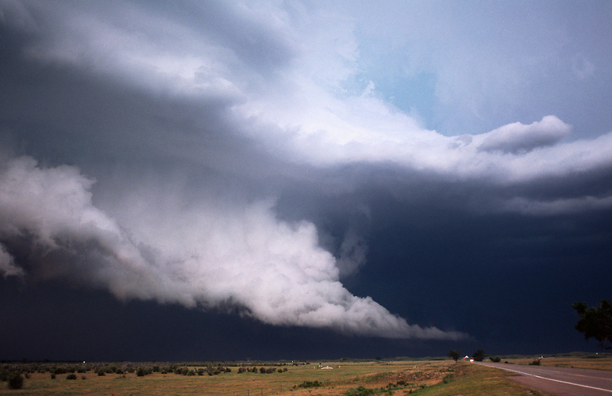 A ghostly-white wall cloud looms over the countryside of western Oklahoma in June. Wall clouds can be precursors to significant tornado activity if rotation is persistent.