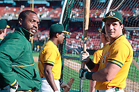 OAKLAND, CA - Dave Parker, left, and Jose Canseco of the Oakland Athletics take batting practice before Game 4 of the 1988 World Series against the Los Angeles Dodgers at the Oakland Coliseum in Oakland, California in 1988. Photo by Brad Mangin