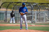 Chicago Cubs starting pitcher Danis Correa (61) prepares to deliver a pitch during an Extended Spring Training game against the Colorado Rockies at Sloan Park on April 17, 2018 in Mesa, Arizona. (Zachary Lucy/Four Seam Images)