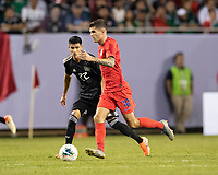 CHICAGO, IL - JULY 7: Christian Pulisic #10 makes a run with Uriel Antuna #22 defending during a game between Mexico and USMNT at Soldiers Field on July 7, 2019 in Chicago, Illinois.