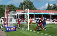 Joe Jacobson of Wycombe Wanderers has his corner tipped onto the bar by goalkeeper Yusuf Mersin of Crawley Town during the Sky Bet League 2 match between Crawley Town and Wycombe Wanderers at Broadfield Stadium, Crawley, England on 6 August 2016. Photo by Alan  Stanford / PRiME Media Images.