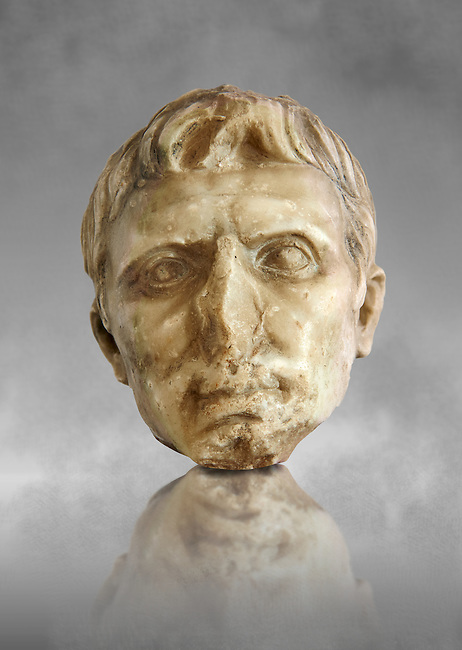 Roman sculpture of the Emperor Augustus, excavated from El-Jem, sculpted circa 27BC-14AD The Bardo National Museum, Tunis, Inv No: C. 72. Against a grey art background.