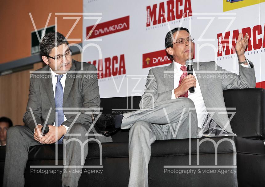 BOGOTA - COLOMBIA - 07 - 05 - 2013: Oscar Campillo (Izq.) director Diario Marca España y German Arango (Der.) director de contenido de Diario Marca Colombia durante Foro en Bogota, mayo 7 de 2013.  El diario Marca Colombia, en su lanzamiento realizo el I FORO COLOMBIA Y ESPAÑA, RUMBO AL MUNDIAL BRASIL2014, (Foto. VizzorImage / Luis Ramirez / Staff). Oscar Campillo (L) Director of Diario Marca España (L) and German Arango (R) Director Brand Content of the Diario Marca Colombia during a Forum in Bogota Colombia, May 7, 2013. The newspaper Marca Colombia, at launch I performed the FORUM COLOMBIA AND SPAIN, WAY TO WORLD BRASIL 2014. (Photo. VizzorImage / Luis Ramirez / Staff).