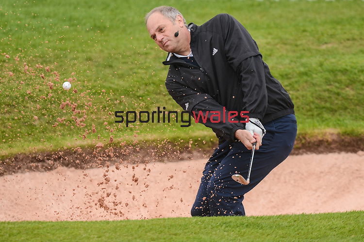England's Sir Steve Redgrave hits a shot out of the bunker during a coaching session ..Celebrity Cup at Golf Live  - Celtic Manor Resort - Friday 10th  May  2013 - Newport ..© www.sportingwales.com- PLEASE CREDIT IAN COOK