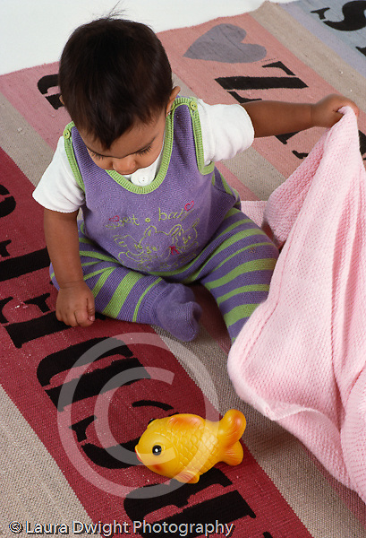 baby girl 10 mos. old Piaget test: object permanence:finding hidden object