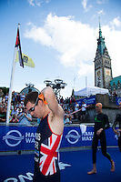 12 JUL 2014 - HAMBURG, GER - Aaron Harris (GBR) of Great Britain prepares for his warm up swim before the  elite men's 2014 ITU World Triathlon Series round in the Altstadt Quarter of Hamburg, Germany (PHOTO COPYRIGHT © 2014 NIGEL FARROW, ALL RIGHTS RESERVED)