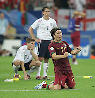 Portuguese defender (14) Nuno Valente celebrates a save by Portuguese goalkeeper (1) Ricardo.  Portugal defeated England on penalty kicks after playing to a 0-0 tie in regulation in their FIFA World Cup quarterfinal match at FIFA World Cup Stadium in Gelsenkirchen, Germany, July 1, 2006.
