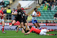 Conor Trainor of Canada evades the tackle of Lee Williams of Wales during the iRB Marriott London Sevens at Twickenham on Saturday 11th May 2013 (Photo by Rob Munro)