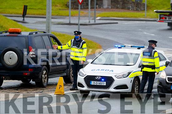 Gardai Alan Clerkin and Michael O'Driscoll on duty at a checkpoint near Castleisland on Wednesday.