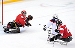Sochi, RUSSIA - Mar 13 2014 - Corbin Watson makes a save as Canada takes on USA in Sledge Hockey Semi-Final at the 2014 Paralympic Winter Games in Sochi, Russia.  (Photo: Matthew Murnaghan/Canadian Paralympic Committee)