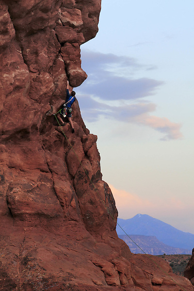 Rock climber on Owl Tower at sunset, Garden ofEdenArea, Arches National Park, Moab, Utah. .  John offers private photo tours in Arches National Park and throughout Utah and Colorado. Year-round.