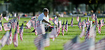 An unidentified man tends to a grave in the veterans section of the Lone Mountain Cemetery in Carson City, Nev., on Sunday, May 25, 2014, in preparation for Monday's Memorial Day ceremony.<br /> Photo by Cathleen Allison