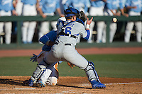Kentucky Wildcats catcher Troy Squires (16) waits for the throw as Zack Gahagan (10) of the North Carolina Tar Heels slides into home plate at Boshmer Stadium on February 17, 2017 in Chapel Hill, North Carolina.  The Tar Heels defeated the Wildcats 3-1.  (Brian Westerholt/Four Seam Images)