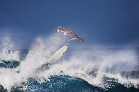 Surfer wipe outs on a large winter wave atBanzai Pipeline on North Shore of Oahu.
