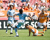 Colorado Rapids defender Ugo Ihemelu (4) clears the ball out of reach of Houston Dynamo forward Brian Ching (25) and Houston Dynamo midfielder Ricardo Clark (13) go up for the header.  Houston Dynamo defeated Colorado Rapids 1-0 at Robertson Stadium in Houston, TX on April 19, 2009.