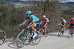 The peloton including Dario Cataldo (ITA) Astana Pro Team climb sector 8 Monte Santa Maria during Strade Bianche 2019 running 184km from Siena to Siena, held over the white gravel roads of Tuscany, Italy. 9th March 2019.<br /> Picture: Seamus Yore   Cyclefile<br /> <br /> <br /> All photos usage must carry mandatory copyright credit (© Cyclefile   Seamus Yore)