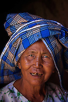 Old women at the hidden Thameewhetumin cave temple Bagan, Myanmar, Burma.