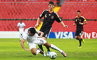 .Action photo of Robin Yalcin (R) of Germany and Mario Rodriguez (L) of USA, during game of the FIFA Under 17 World Cup game, held at Queretaro.