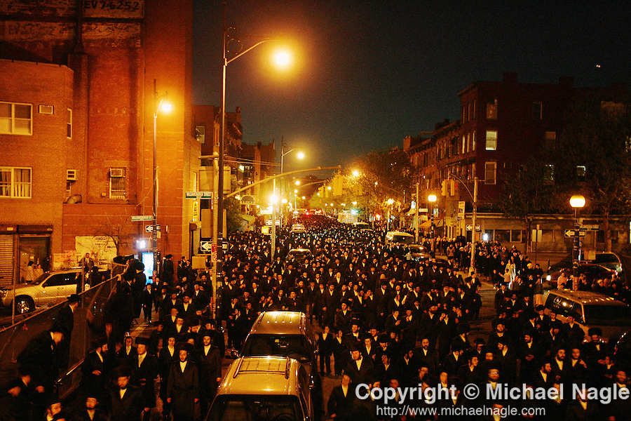 BROOKLYN -- APRIL 29, 2006:  Thousands of members of the Satmar community walk Rabbi Aaron Teitelbaum home after attending services in a makeshift tent synagogue on a baseball field in a park at Taylor Street and Lee Avenue in Williamsburg on April 29, 2006 in Brooklyn.  (PHOTOGRAPH BY MICHAEL NAGLE)