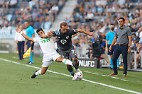SAINT PAUL, MN - JUNE 23: Chase Gasper #77 of Minnesota United FC and Rodney Redes #11 of Austin FC battle for the ball during a game between Austin FC and Minnesota United FC at Allianz Field on June 23, 2021 in Saint Paul, Minnesota.