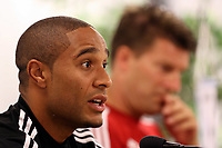 Wednesday 07 August 2013<br /> Pictured L-R: Team captain Ashley Williams and manager Michael Laudrup during a press conference in Malmo, Sweden.<br /> Re: Swansea City FC travelling to Sweden for their Europa League 3rd Qualifying Round, Second Leg game against Malmo.